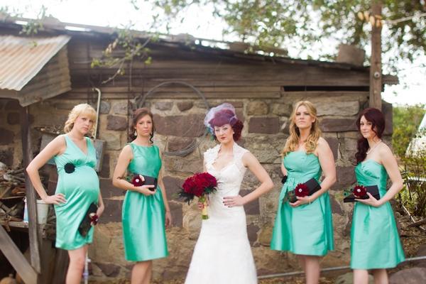 Bride with bridesmaids wearing green bridesmaid dresses