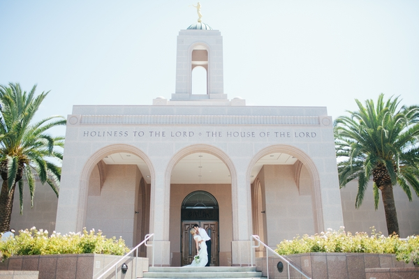 Bride and groom outside LDS Newport Beach Temple