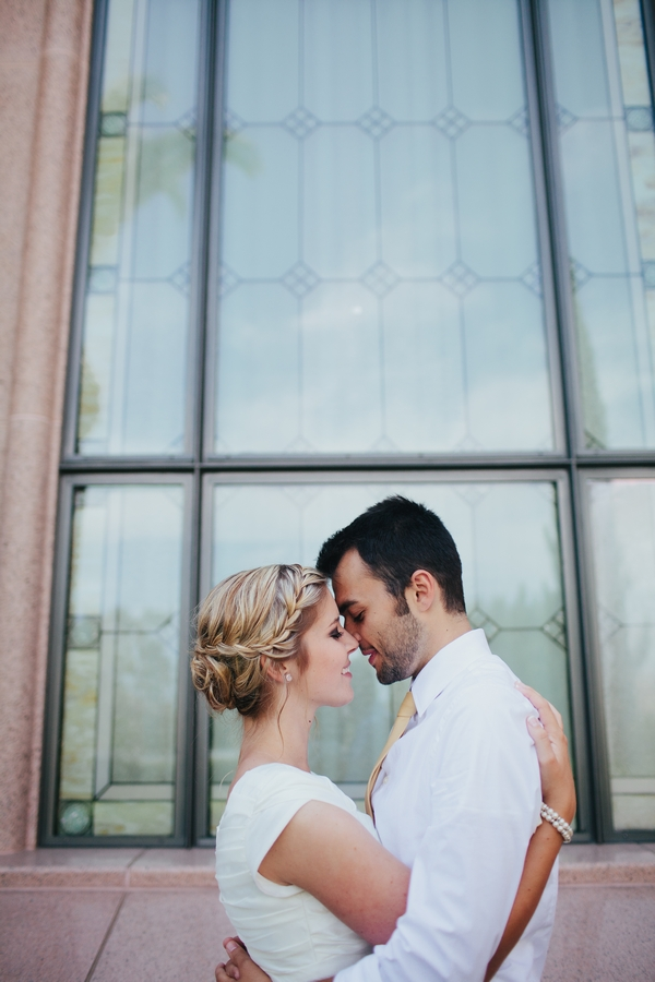 Bride and groom in front of window