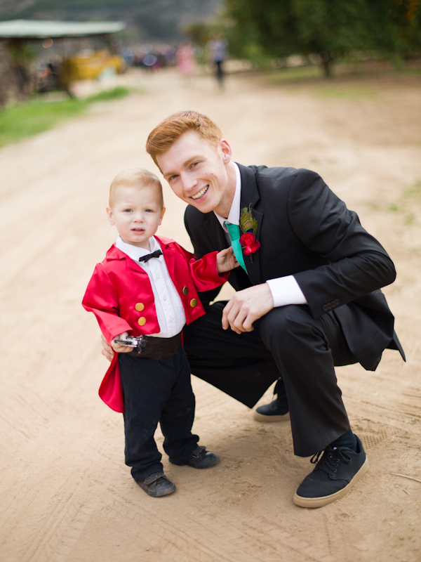 Small boy in cicus master wedding outfit