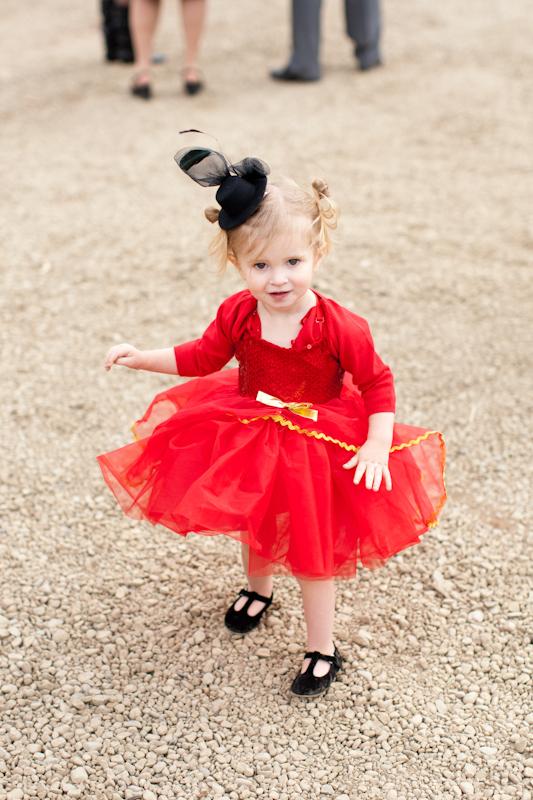 Small girl in red flower girl dress
