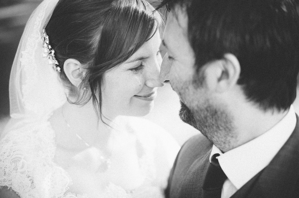Black and white picture of bride and groom touching noses - Picture by Aaron Collett Photography