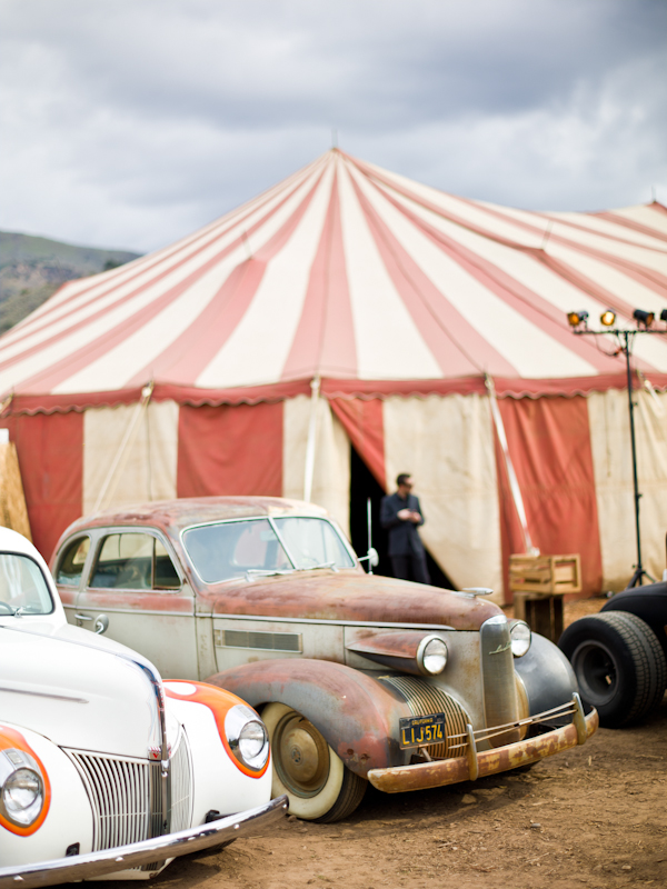Old cars outside circus tent