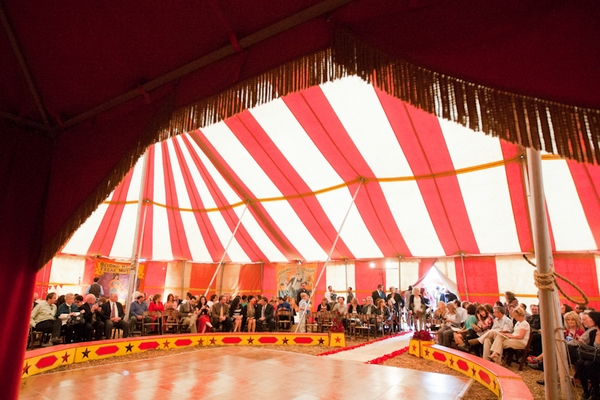 Wedding guests in circus tent for wedding ceremony