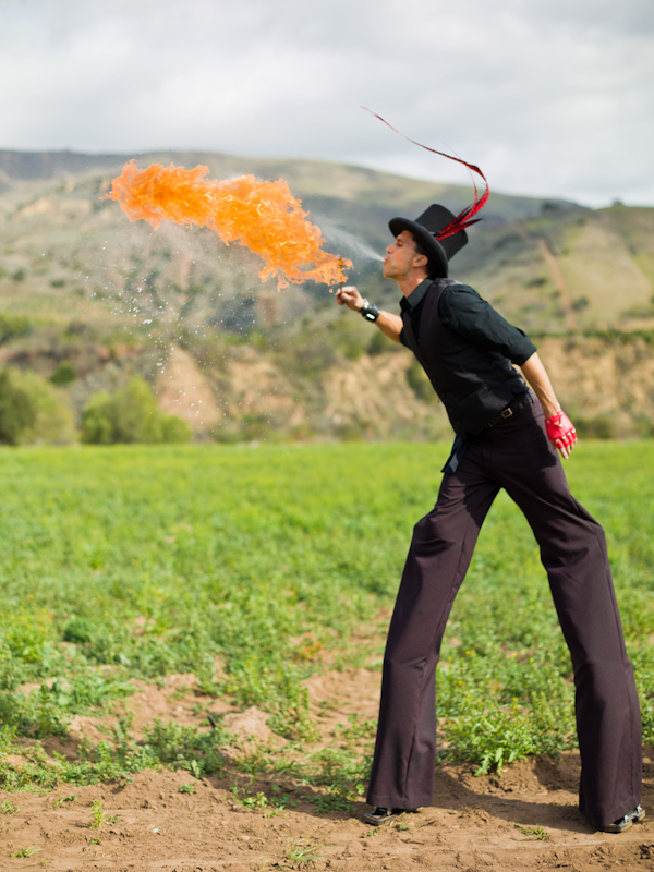 Circus performer blowing fire