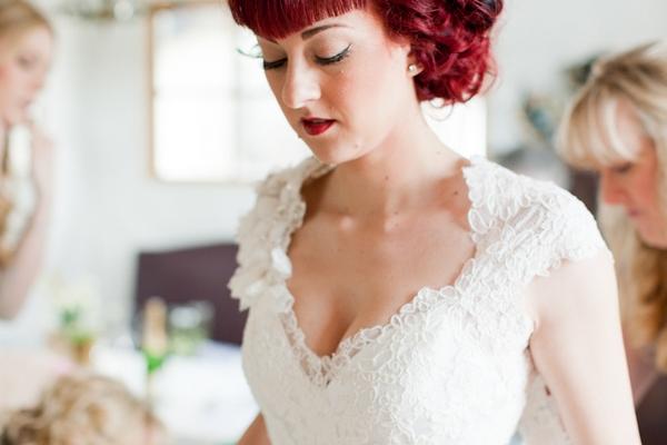 Redhead bride wearing lace wedding dress