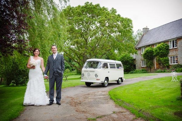 Bride and groom standing in front of a VW camper - Picture by Aaron Collett Photography