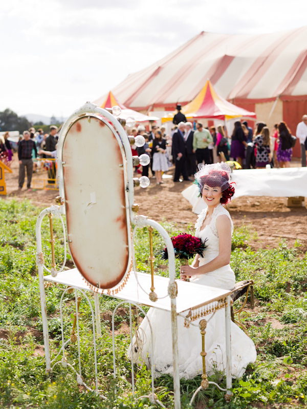 Bride sitting in front of circus mirror