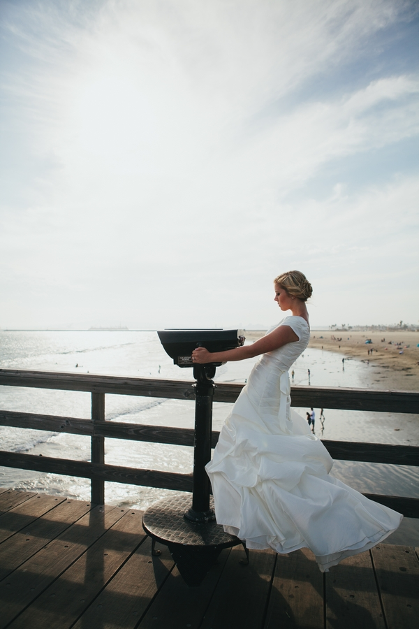Bride leaning back on pier