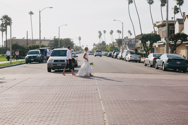 Bride and groom walking across road