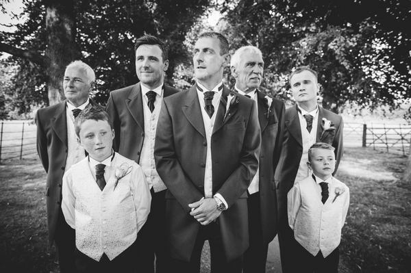 Black and white picture of groomsmen posing - Picture by Aaron Collett Photography