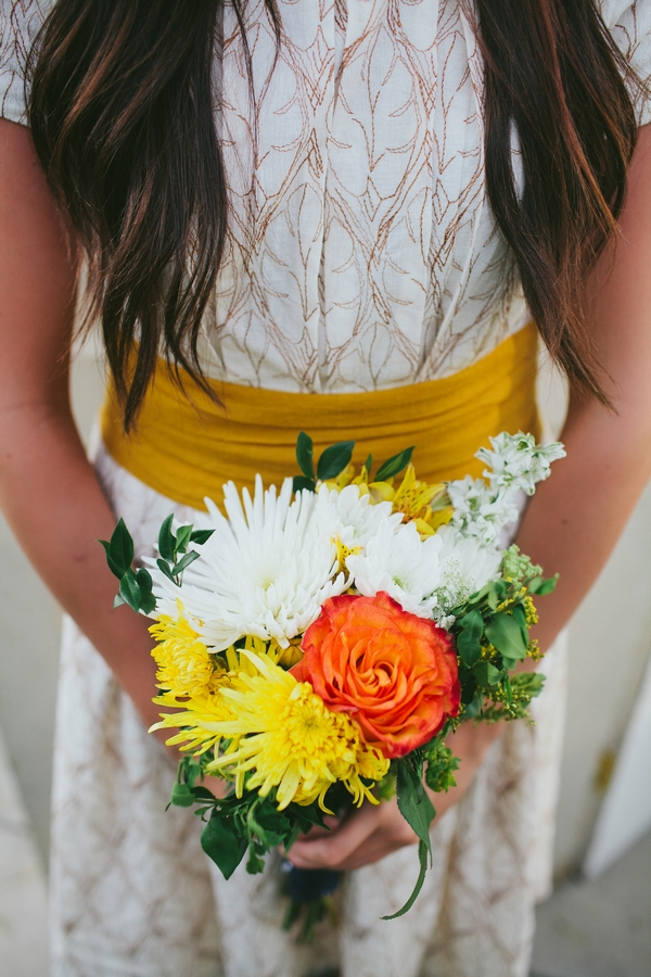Bouquet of yellow, orange and white flowers