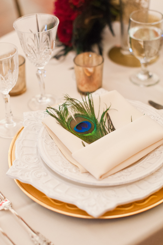 Napkin on wedding table with peacock feather