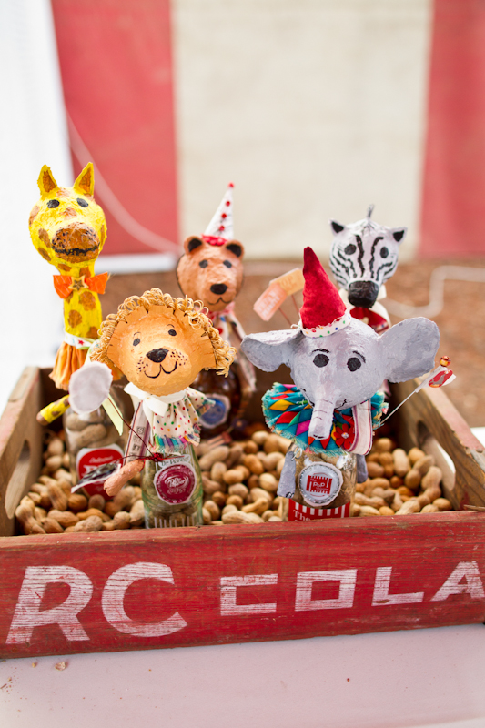 Bottles with circus animal toppers