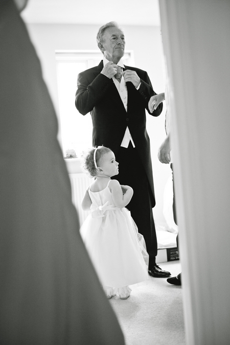 Father of bride adjusting tie - Picture by Karli Harrison Photography