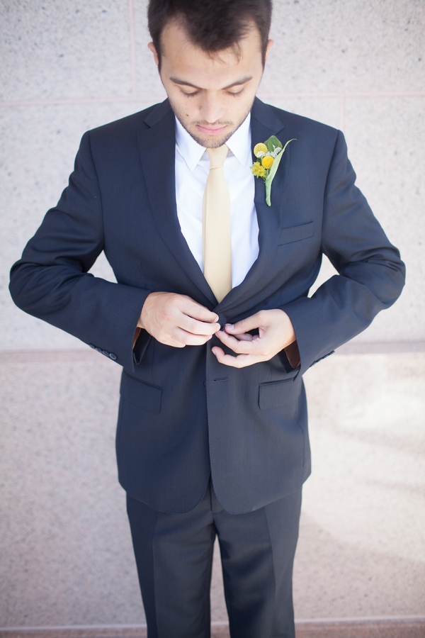 Groom doing up jacket