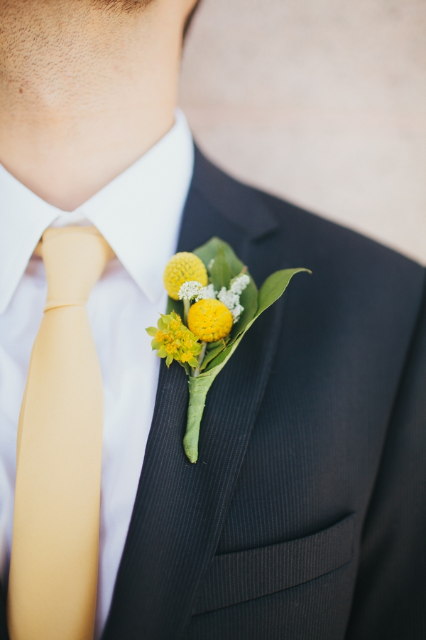 Yellow buttonhole on groom's jacket