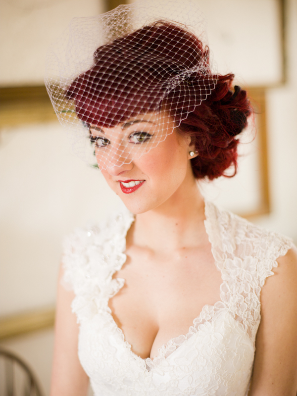 Bride in lace dress and birdcage veil