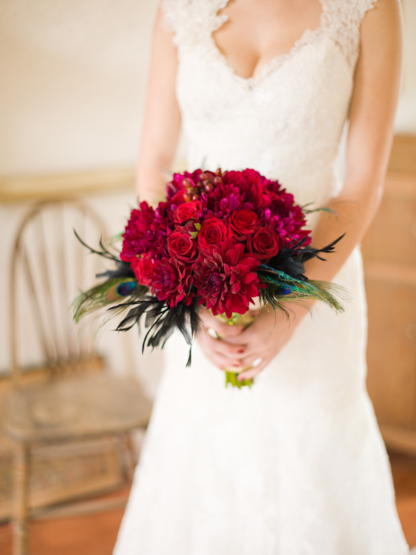 Bride holding red rose bridal bouquet