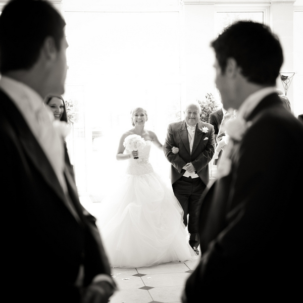Groom watching bride walk down the aisle - Picture by Aaron Collett Photography