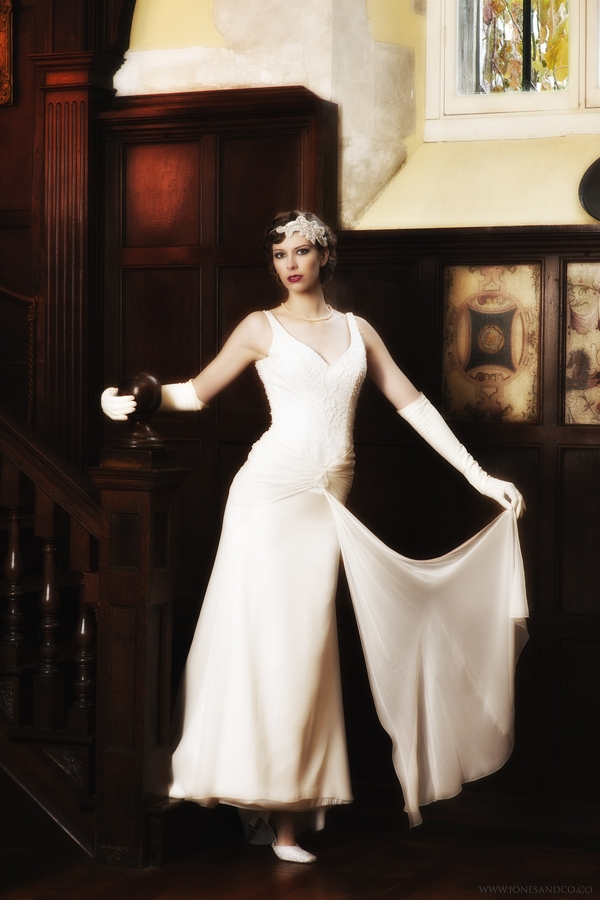 1920's bride at bottom of stairs