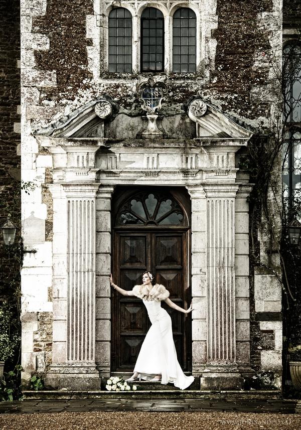 1920's bride in doorway of Loseley Park