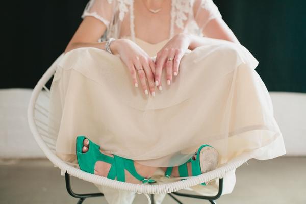 Bride sitting with legs crossed