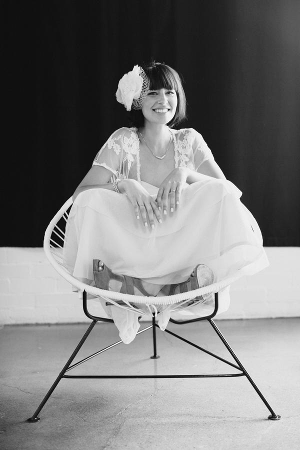 Bride sitting cross legged on chair