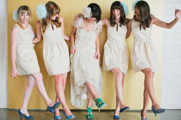 Bride and bridesmaids kicking legs