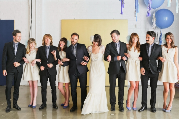Bridal party with arms linked