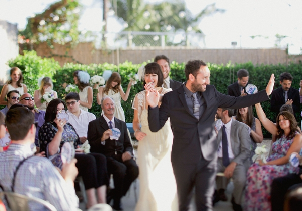 Bride and groom walk back down aisle as husband and wife
