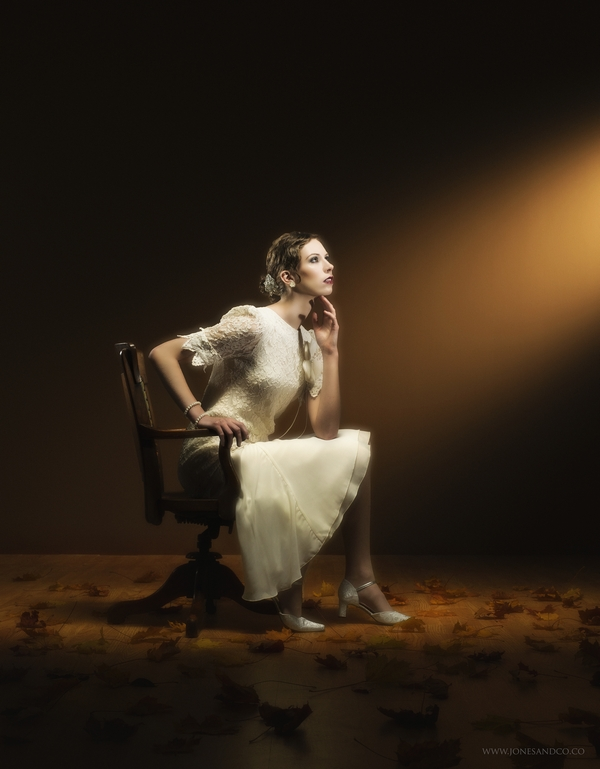1920's bride sitting on chair