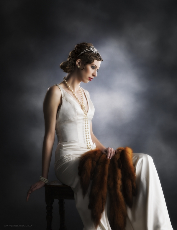 1920's bride posing on chair