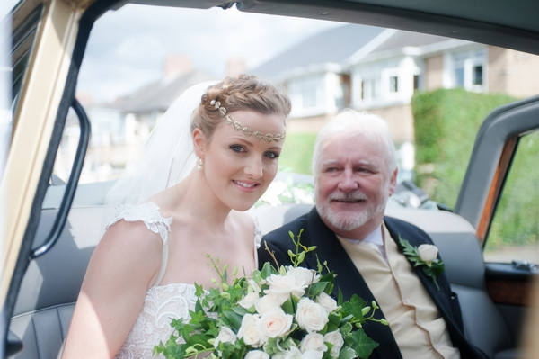 Bride with father in wedding car