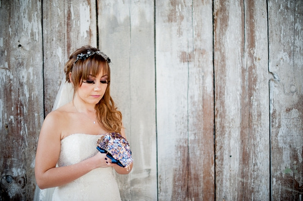 Bride holding brooch bouquet