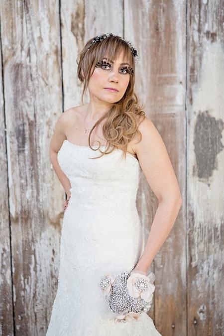 Bride posing with brooch bouquet