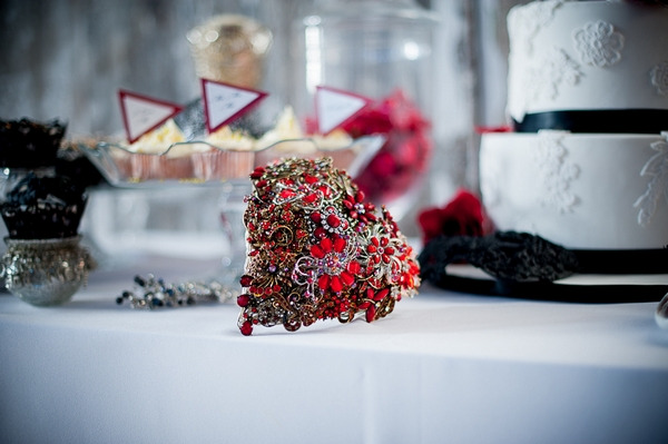 Red heart brooch bouquet on table