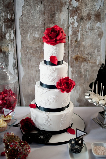 White tiered wedding cake with red and black