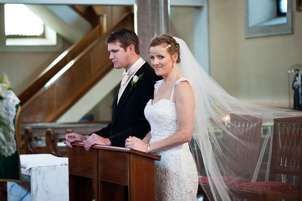 Bride looking at camera in wedding ceremony