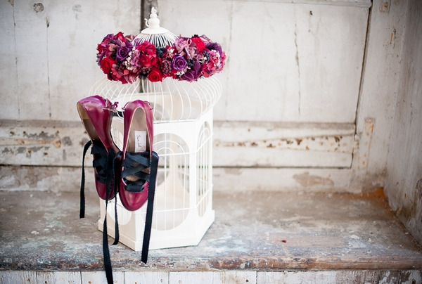 Shoes hanging from birdcage