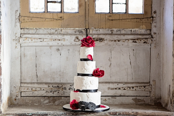 Tiered red and white wedding cake