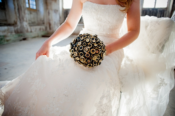 Bride sitting holding brooch bouquet