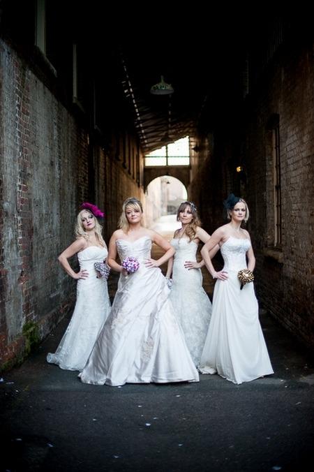 Brides standing under arch