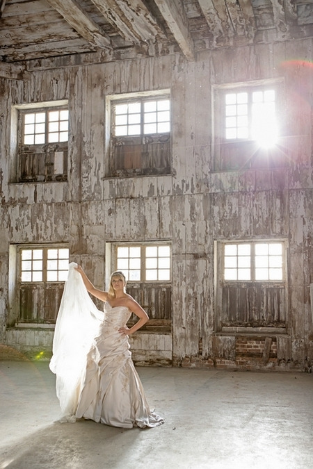 Bride holding up train on wedding dress