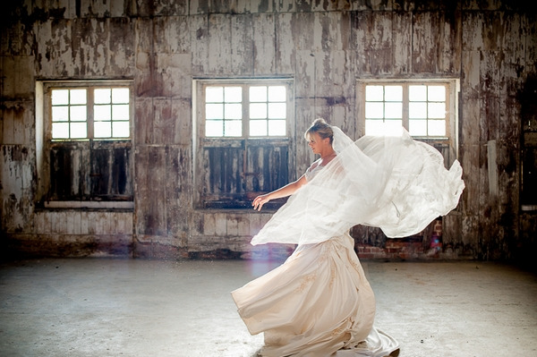 Bride twirling with veil flowing