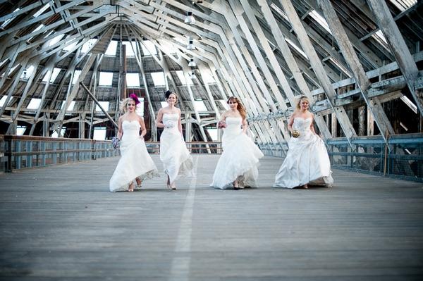 Four brides walking
