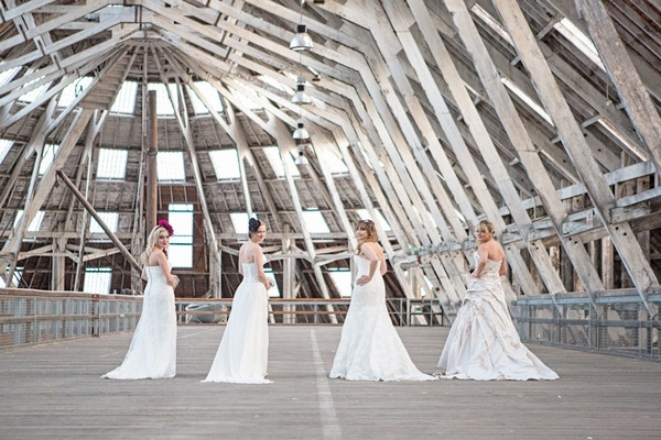 Four brides with back to camera