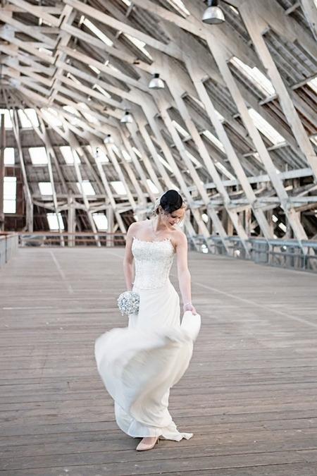 Bride wearing top hat headpiece