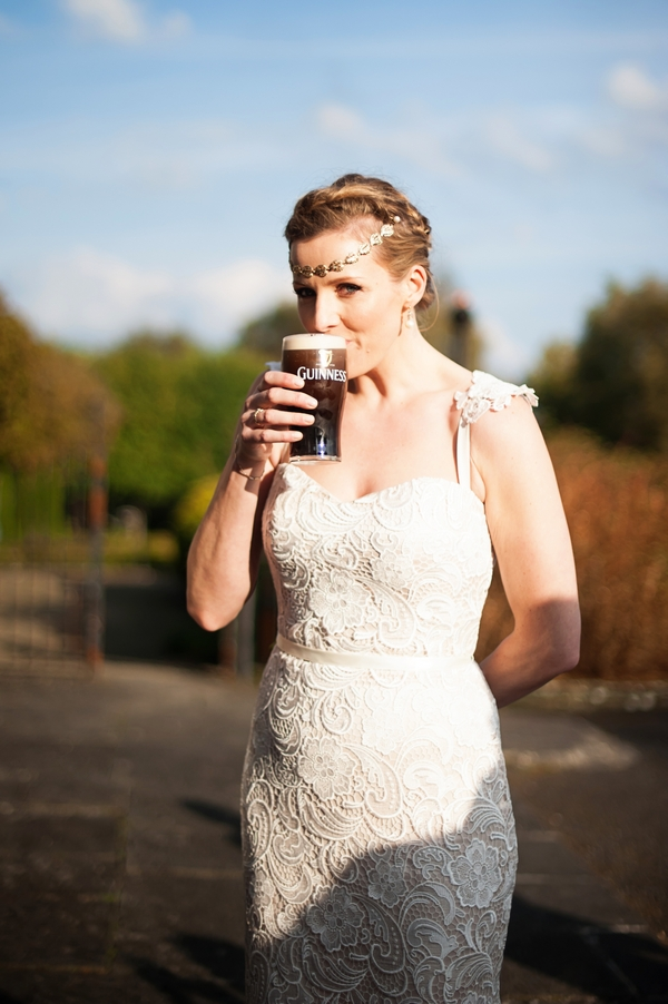 Bride drinking pint of Guinness