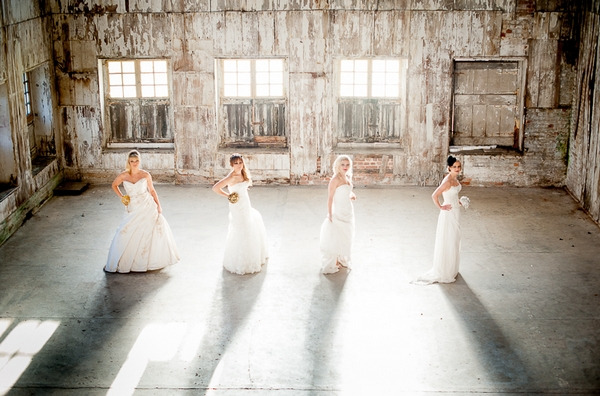 Four brides in line in warehouse